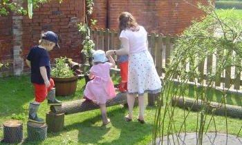 Children being looked after by staff at Staunton Montessori Nursery School