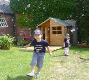 Blowing bubbles in the play area