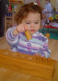 Using the Montessori Cylinders - Pre-school child